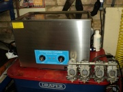 Ultrasonic carb cleaning service.